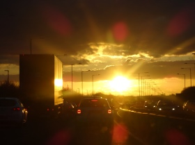 Watching the sunset through the traffic whilst driving home, it really is beautiful.
